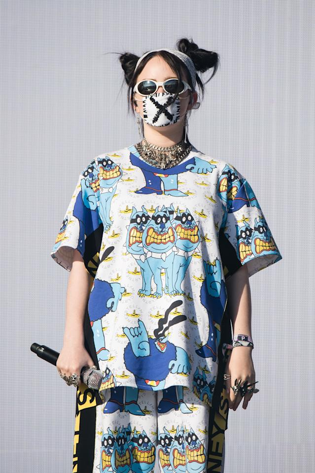 The oversized t-shirt, matching shorts, space buns, and white sunglasses solidified this outfit as eternal inspiration for our summer closet.