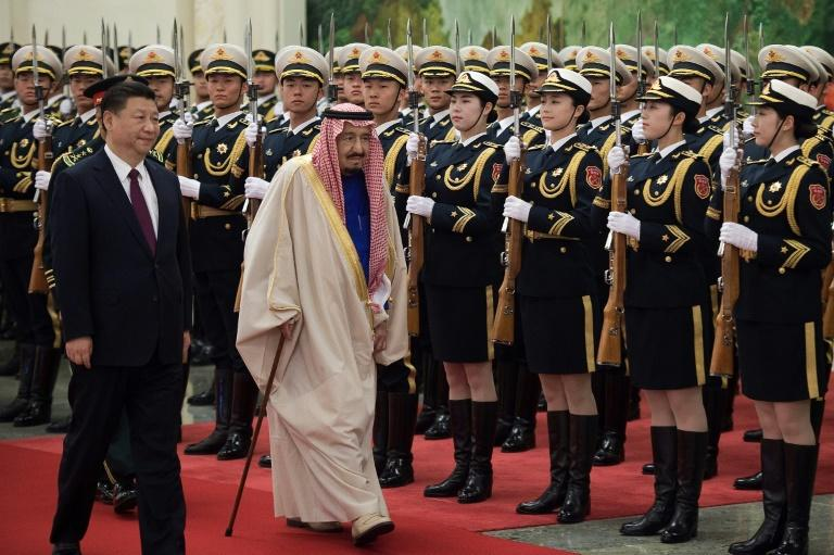 Saudi King Salman bin Abdulaziz (centre) reviews an honour guard during a welcoming ceremony at the Great Hall of the People in Beijing, on March 16, 2017