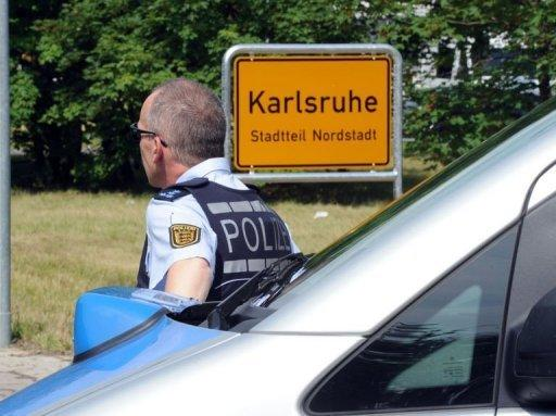 Police say the gunman has barricaded himself inside an apartment in Karlsruhe