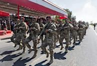 Soldiers parade in the northern part of Cyprus's divided capital Nicosia on July 20, 2021