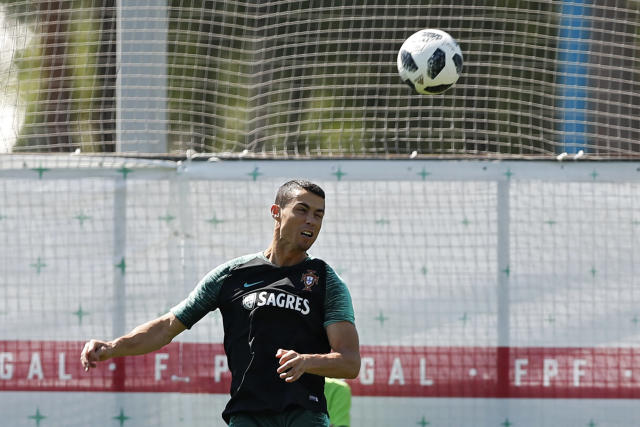 Portugal's Cristiano Ronaldo heads the ball during the training session of Portugal at the 2018 soccer World Cup in Kratovo, outskirts Moscow, Russia, Sunday, June 17, 2018. (AP Photo/Francisco Seco)