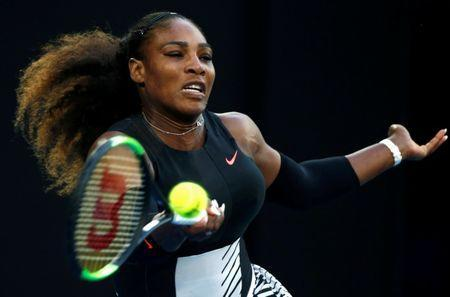 Serena Williams of the U.S. hits a shot during her Women's singles final match against Venus Williams of the U.S. .REUTERS/Thomas Peter/File Photo