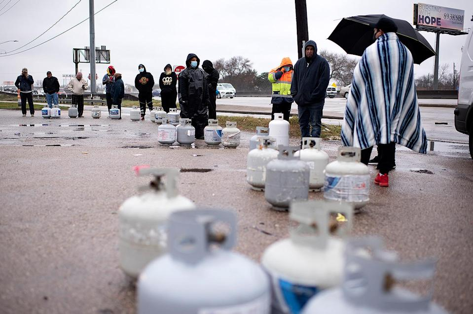 <p>Propane tanks are placed in a line as people wait for the power to turn on so that they can fill them in Houston, Texas, on Feb. 17. </p>