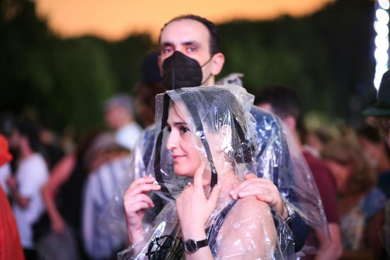 People leave the 'We Love NYC: The Homecoming Concert' in Central Park as the event was canceled due to weather