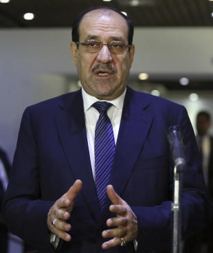 Iraqi Prime Minister Nouri al-Maliki, left, speaks during a press conference with the Sunni Speaker of Parliament Salim al-Jubouri, in Baghdad, Iraq, Saturday, July 26, 2014. Gunmen traveling in black SUVs seized Riyadh al-Adhdah, a senior Sunni politician who had previously been jailed on terrorism charges, from his home in Baghdad on Saturday, police officers said. Al-Maliki discussed al-Adhdah's disappearance with al-Jubouri at a meeting Saturday. The incident comes at a time of mounting sectarian tensions, with Sunni militants having seized vast swaths of northern and western Iraq and Shiite militias having mobilized to help the beleaguered armed forces fight back. (Hadi Mizban/AP Photo)