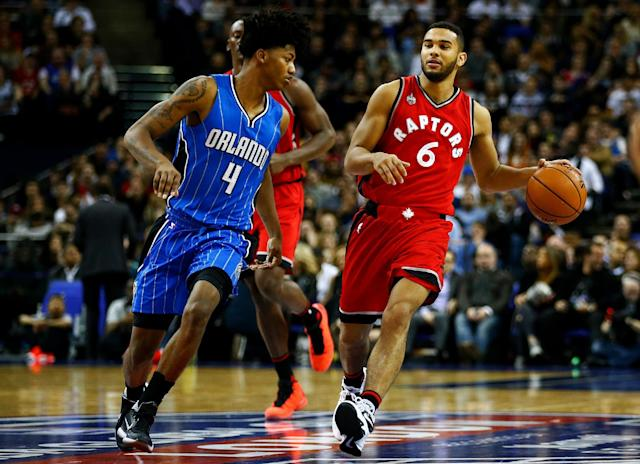 LONDON, ENGLAND - JANUARY 14: Cory Joseph #6 of the Toronto Raptors dribbles towards Elfrid Payton #4 of the Orlando Magic during the 2016 NBA Global Games London match between Toronto Raptors and Orlando Magic at The O2 Arena on January 14, 2016 in London, England. (Photo by Clive Rose/Getty Images)