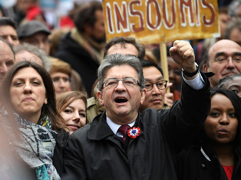 French presidential election candidate for the far-left coalition 'La France insoumise' Jean-Luc Melenchon raises his fist as he takes part in the March for the 6th Republic: ERIC FEFERBERG/AFP/Getty Images