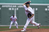 Boston Red Sox starting pitcher Nathan Eovaldi delivers to the Chicago White Sox in the second inning of a baseball game at Fenway Park, Monday, April 19, 2021, in Boston. (AP Photo/Elise Amendola)