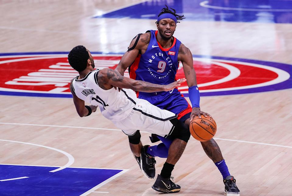 Jerami Grant is fouled by Nets guard Kyrie Irving on Feb. 9. The Pistons face the Nets twice in the second half.