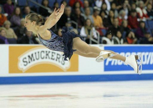 Carolina Kostner, pictured in October 2011, grabbed the first ticket for next month's showpiece finals in Quebec City after the talented Italian skater dazzled at the ISU Cup of China Grand Prix series on Saturday