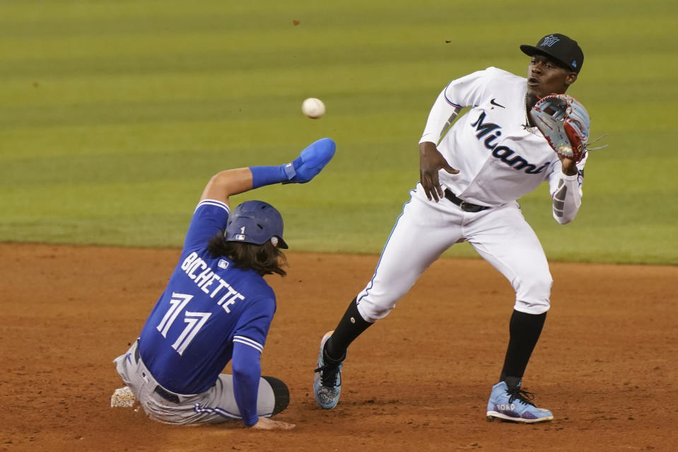 Toronto Blue Jays' Bo Bichette, left, steals second base as Miami Marlins second baseman Jazz Chisholm Jr., right, is late with the catch, during the sixth inning of a baseball game, Tuesday, June 22, 2021, in Miami. (AP Photo/Marta Lavandier)