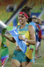 "FILE - In this Aug. 19, 2016, file photo, Chloe Esposito of Australia crosses the finish line to win the gold medal in the women's modern pentathlon at the Summer Olympics in Rio de Janeiro, Brazil. Esposito announced in late January that a ""wonderful, unexpected surprise"" had occurred and that the Australian wouldn't be able to defend her modern pentathlon gold medal at the Tokyo Olympics. She was pregnant with her first child. Two months later Esposito and thousands of other Olympic athletes learned that the Tokyo Games would be put off by a year until July 2021 because of the coronavirus pandemic. While for some it meant more time to recover from injuries or extra time to prepare, Esposito realized it might give her a second chance to be in Tokyo next year. (AP Photo/Natacha Pisarenko, File)"
