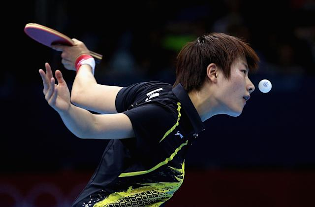 LONDON, ENGLAND - JULY 31: Ning Ding of China plays a forehand during the Women's Singles Table Tennis quarter-final match against Ai Fukuhara of Japan on on Day 4 of the London 2012 Olympic Games at ExCeL on July 31, 2012 in London, England. (Photo by Feng Li/Getty Images)