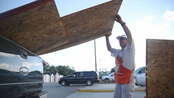 PHOTO: Home Depot employee Richard Balderson helps a customer load plywood into his truck as residents prepare for the arrival of Hurricane Florence, Sept. 11, 2018, in Myrtle Beach, S.C. (Joe Raedle/Getty Images)