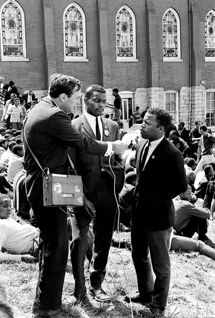 John Lewis, right, and Lester McKinnie, center, are interviewed by ABC News at the sit-in demonstrators' base at the First Baptist Church in Nashville on April 30, 1964. | J.T. Phillips—The Tennessean/Imagn Content Services/USA Today Network/Reuters