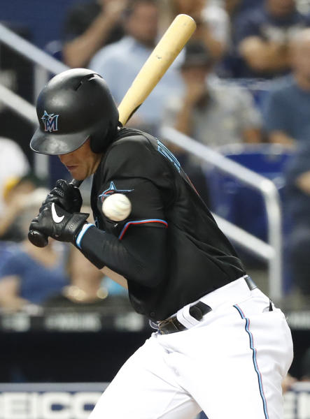 Miami Marlins' Brian Anderson is hit by a pitch during the fourth inning of the team's baseball game against the Pittsburgh Pirates, Saturday, June 15, 2019, in Miami. (AP Photo/Wilfredo Lee)