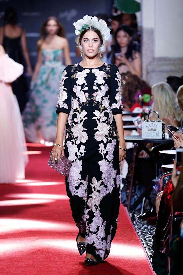 <p>Le Bon — the 28-year-old daughter of Duran Duran frontman Simon Le Bon and model Yasmin Le Bon — took to the catwalk in a floral black dress. (Photo: Getty Images) </p>