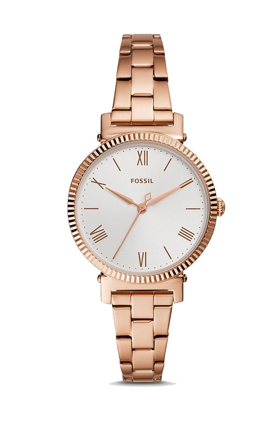 """<p><strong>Fossil</strong></p><p>fossil.com</p><p><strong>$119.00</strong></p><p><a href=""""https://go.redirectingat.com?id=74968X1596630&url=https%3A%2F%2Fwww.fossil.com%2Fen-us%2Fproducts%2Fdaisy-three-hand-rose-gold-tone-stainless-steel-watch%2FES4791.html&sref=https%3A%2F%2Fwww.townandcountrymag.com%2Fstyle%2Fjewelry-and-watches%2Fg36186288%2Fbest-rose-gold-watches-women%2F"""" rel=""""nofollow noopener"""" target=""""_blank"""" data-ylk=""""slk:Shop Now"""" class=""""link rapid-noclick-resp"""">Shop Now</a></p><p>A statement oversized watch face is complemented by a thinner metal watchband. </p>"""