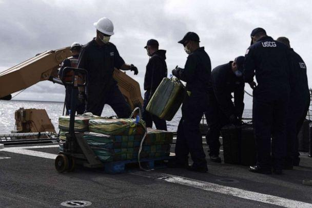 PHOTO: Coast Guard Cutter Bertholf (WMSL 750) crew members palletize bales of contraband on the cutter's flight deck following an at-sea interdiction of a low-profile go-fast vessel during Bertholf's patrol of the Eastern Pacific Ocean, Nov. 4, 2019. (U.S. Coast Guard photo by Petty Officer 2nd Class Paul Krug)