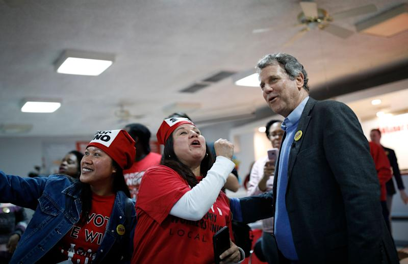 U.S. Sen. Sherrod Brown, D-Ohio, right, greets workers during a visit to a Culinary Union hall Saturday, Feb. 23, 2019, in Las Vegas. (Photo: John Locher/AP)