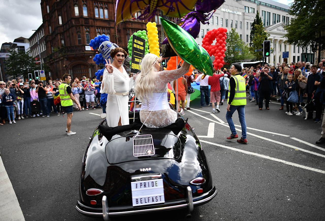 <p>Drag queens wave to the crowd as Belfast Gay Pride takes place on August 5, 2017 in Belfast, Northern Ireland. (Photo: Charles McQuillan/Getty Images) </p>
