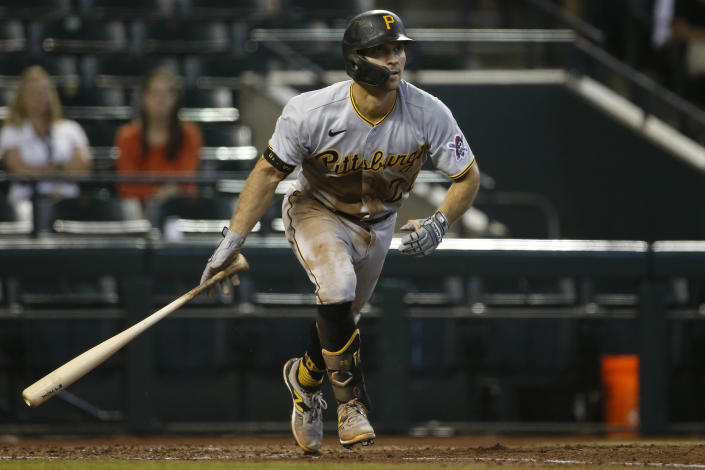 PHOENIX, ARIZONA - JULY 21: Adam Frazier #26 of the Pittsburgh Pirates grounds out during an at-bat against the Arizona Diamondbacks in the fourth inning of the MLB game at Chase Field on July 21, 2021 in Phoenix, Arizona. (Photo by Ralph Freso/Getty Images)