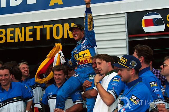 "Michael Schumacher, Benetton celebrates his world title with the Benetton team <span class=""copyright"">Sutton Motorsport Images</span>"