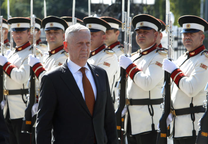 U.S. Defense Secretary James Mattis walks past an honor guard squad during a welcome ceremony upon his arrival at the government building in Skopje, Macedonia, Monday, Sept. 17, 2018. Mattis arrived in Macedonia Monday, condemning Russian efforts to use its money and influence to build opposition to an upcoming vote that could pave the way for the country to join NATO, a move Moscow opposes. (AP Photo/Boris Grdanoski)