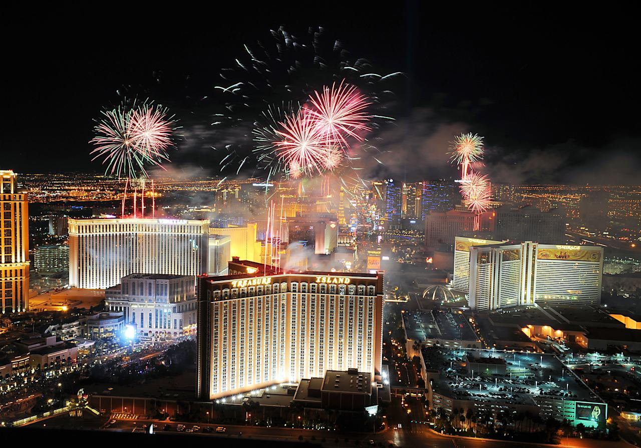 LAS VEGAS, NV- JANUARY 1: (NO SALES, NO ARCHIVE) In this photo provided by the Las Vegas News Bureau, fireworks burst over the Las Vegas Strip at midnight on New Year's 2013, as seen from Trump Las Vegas January 1, 2013 in Las Vegas, Nevada. Las Vegas officials expect to welcome approximately 332,000 visitors for the holiday. (Photo by Steve Spatafore/Las Vegas News Bureau via Getty Images)