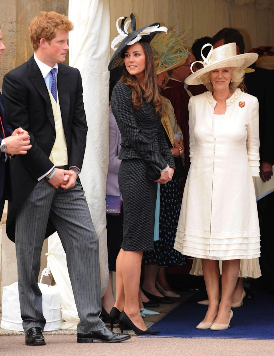 <p>Talking to Prince Harry and Camilla, Duchess of Cornwall, at the Order of the Garter service at St. George's Chapel, Windsor Castle. </p>