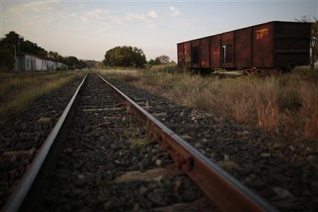 An abandoned train wagon is pictured on the tracks of the Goias Railroad in Calambau