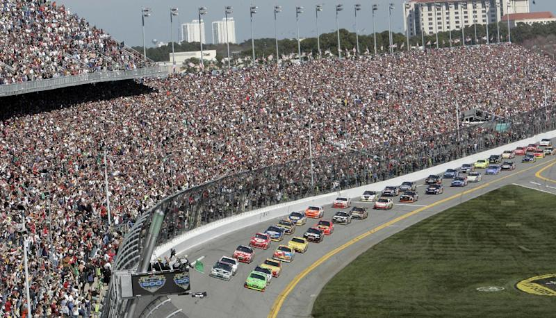 FILE - In this Feb. 14, 2010, file photo, drivers take the green flag for the start of the NASCAR Daytona 500 auto race at Daytona International Speedway in Daytona Beach, Fla. Daytona International Speedway president Joie Chitwood announced, on Tuesday, Jan. 22, 2013, a proposed multi-year redevelopment of the historic racetrack.  The plan includes five new modern entrances, a second pedestrian bridge for easier access to the track and an expanded grandstand area with thousands of more seats.  (AP Photo/David Graham, File)