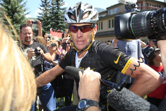 FILE - In this Aug. 25, 2012 file photo, Lance Armstrong talks to reporters after his second-place finish in the Power of Four mountain bicycle race at the base of Aspen Mountain in Aspen, Colo. Nike Inc. is cutting ties with the Livestrong cancer charity founded by Armstrong. The move by the sports company is the latest fallout in the doping scandal surrounding the former cyclist, who now admits he used performance-enhancing drugs to win the Tour de France seven times. (AP Photo/David Zalubowski, FIle)