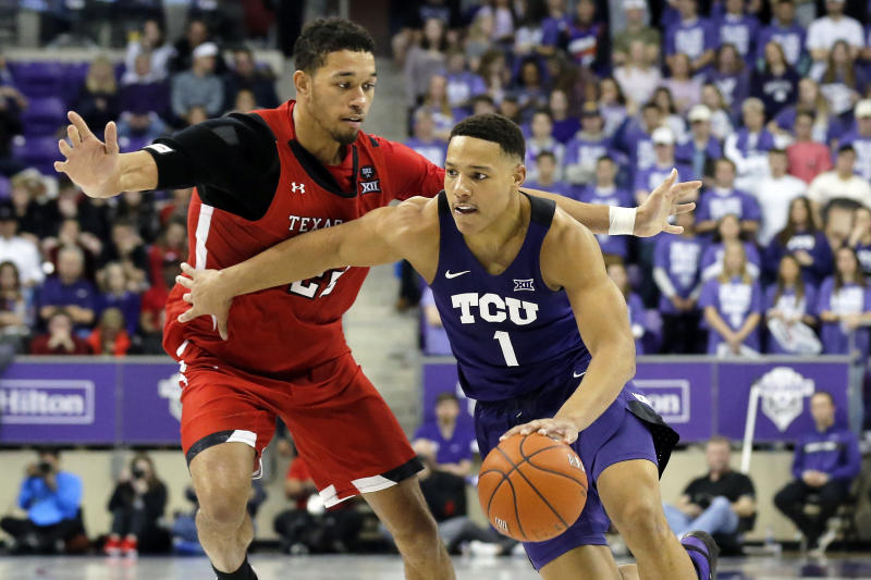 TCU guard Desmond Bane, right, drives to the basket as Texas Tech forward TJ Holyfield, left, defends during the second half of an NCAA college basketball game in Fort Worth, Texas, Tuesday, Jan. 21, 2020. TCU won 65-54. (AP Photo/Ray Carlin)