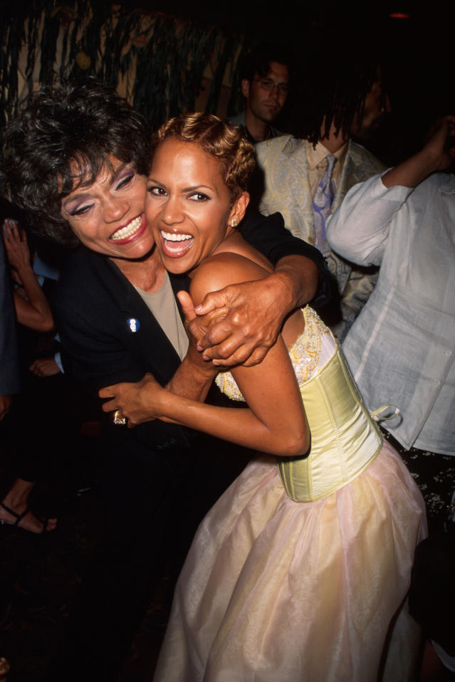 <p>Meow! Future movie Catwoman Berry embraces TV Catwoman Eartha Kitt at the Los Angeles premiere of the biopic.<br> (Photo: Getty Images) </p>