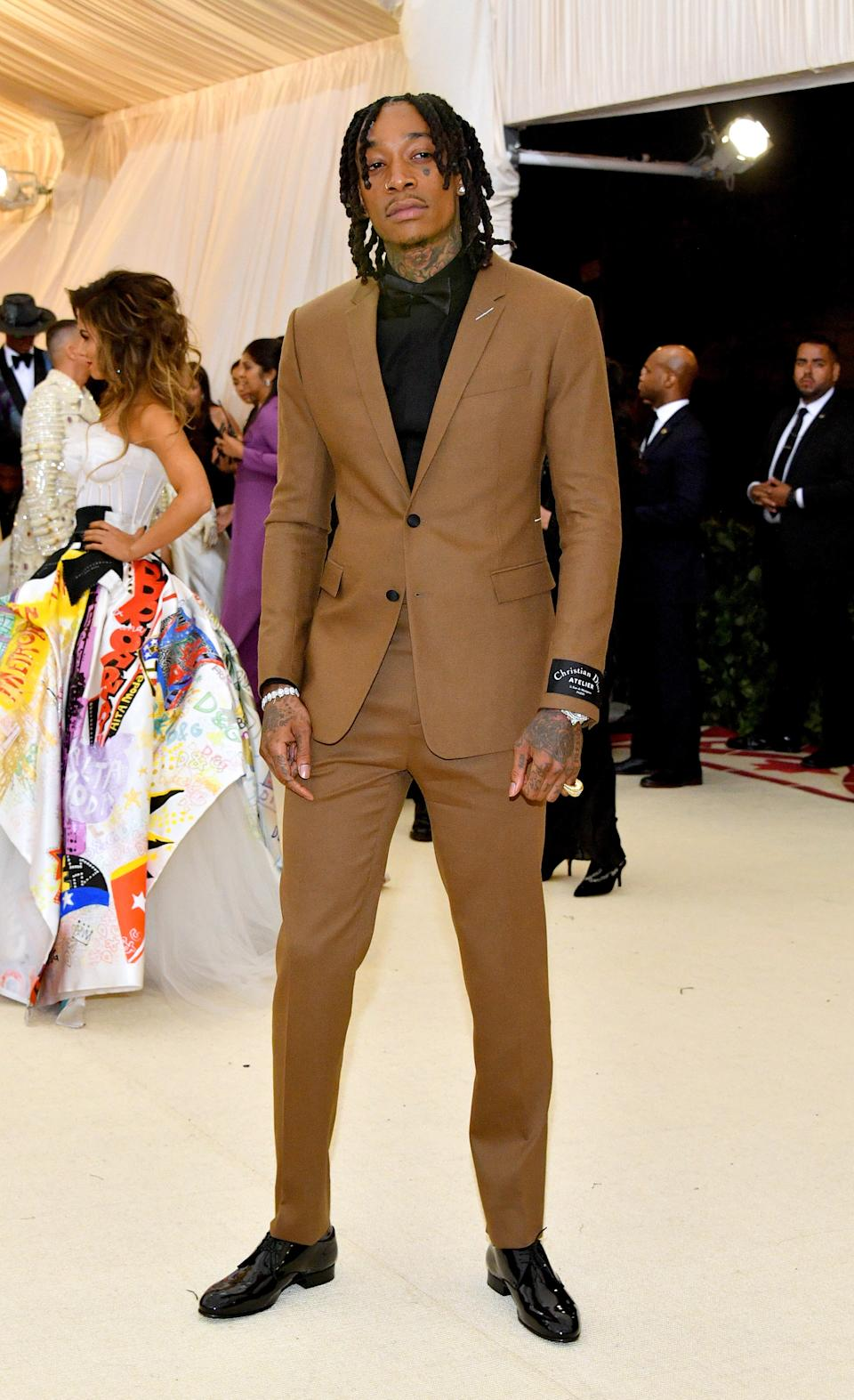 """<h1 class=""""title"""">Wiz Khalifa in Dior Homme</h1><cite class=""""credit"""">Photo: Getty Images</cite>"""