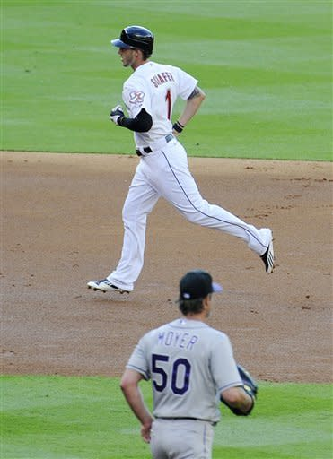 Houston Astros' Jordan Schafer (1) rounds the bases after hitting a home run against Colorado Rockies pitcher Jamie Moyer (50) in the first inning of a baseball game Saturday, April 7, 2012, in Houston. (AP Photo/Pat Sullivan)