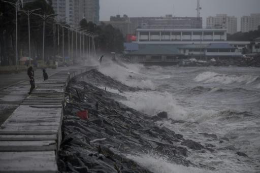 Strong waves, whipped up by powerful winds, pound have pounded Manila's waterfront