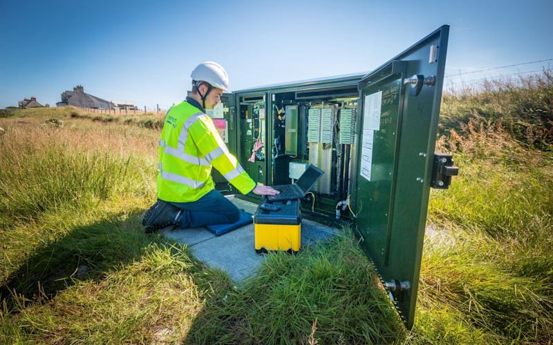 Photo issued by BT of Openreach engineer Stuart MacDonald in North Tolsta, as the remote community in the Western Isles is the first in Scotland to test increased broadband speeds over long phone lines - PA