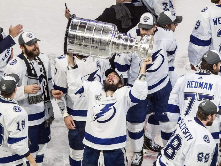 FILE - In this Sept. 28, 2020, file photo, Tampa Bay Lightning's Nikita Kucherov (86) hoists the Stanley Cup after defeating the Dallas Stars in the NHL Stanley Cup hockey finals in Edmonton, Alberta. Kucherov is expected to miss the entire regular season because of a hip injury that requires surgery. General manager Julien BriseBois ruled out Kucherov for the 56-game season that begins Jan. 13 and ends May 8. (Jason Franson/The Canadian Press via AP, File)