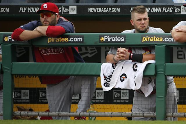 St. Louis Cardinals' Lance Lynn, left, and Matt Adams watch from the dugout railing during the ninth inning of a baseball game in Pittsburgh Wednesday, Aug. 27, 2014. The Pirates won 3-1. (AP Photo/Gene J. Puskar)