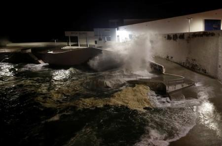 Waves crash on a wall along the coast near Angra do Heroismo, before the arrival of Hurricane Lorenzo in Azores
