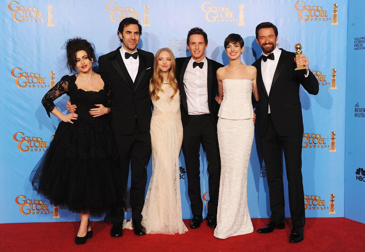 "(L-R) Actors Helena Bonham Carter, Sacha Baron Cohen, Amanda Seyfried, Eddie Redmayne, Anne Hathaway and Hugh Jackman of ""Les Miserables"" pose in the press room during the 70th Annual Golden Globe Awards held at The Beverly Hilton Hotel on January 13, 2013 in Beverly Hills, California.  (Photo by Kevin Winter/Getty Images)"
