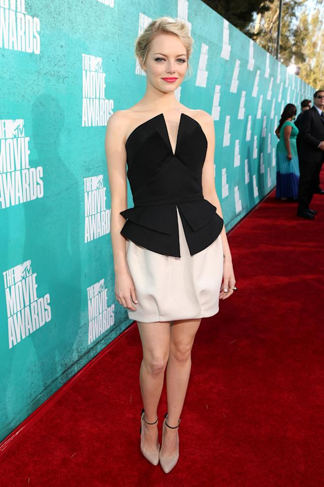 Emma Stone arrives at the 2012 MTV Movie Awards.