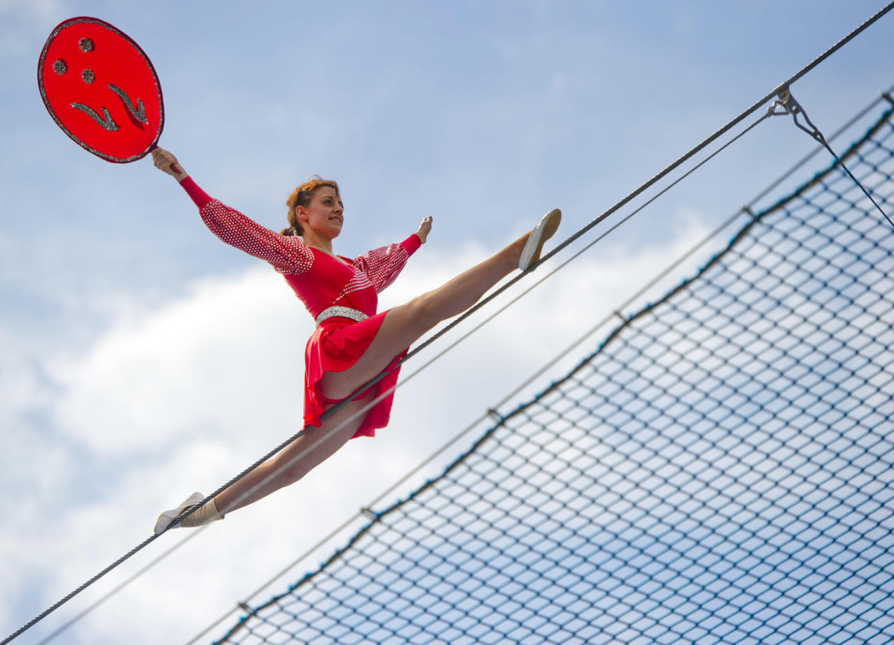 "A high-wire dancer of the acrobat group ""Geschwister Weisheit"" (wisdom siblings) performs on the tightrope on May 25, 2013 during the German Gymnastics Festival in Frankfurt am Main, western Germany. The gymnastics competition and sports-for-all event is running until May 25, 2013 in several venues of the Rhine-Neckar region. Organisers expect more than 80,000 participants. AFP PHOTO / Nicolas Armer"