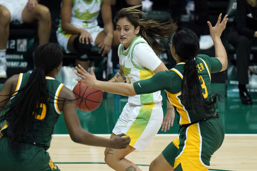 South Florida guard Maria Alvarez (1) drives around Baylor guard Trinity Oliver (3) and center Queen Egbo (25) during the second half of an NCAA women's college basketball game Tuesday, Dec. 1, 2020, in Tampa, Fla. (AP Photo/Chris O'Meara)