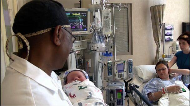 PHOTO: Dr. Andrew Carey Jaja sings to a newborn baby at at UPMC Magee-Womens Hospital in Pittsburgh. (UPMC Magee-Womens Hospital)