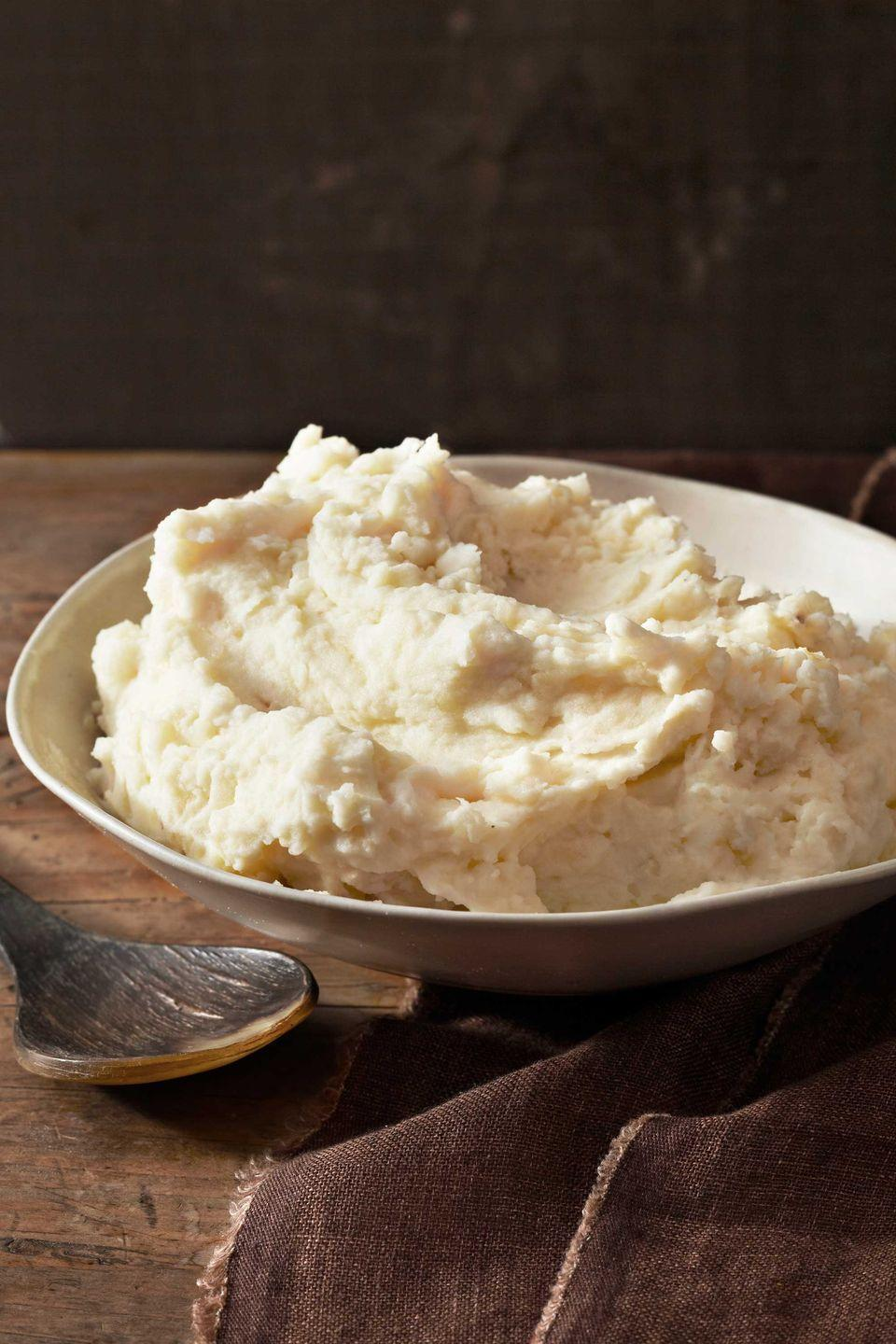 "<p>The key to these perfectly creamy mashed potatoes is not overstirring them once the half-and-half has been added.</p><p><strong><a href=""https://www.countryliving.com/food-drinks/recipes/a3570/the-ultimate-mashed-potatoes-recipe-clv0211/"" rel=""nofollow noopener"" target=""_blank"" data-ylk=""slk:Get the recipe"" class=""link rapid-noclick-resp"">Get the recipe</a>.</strong></p>"