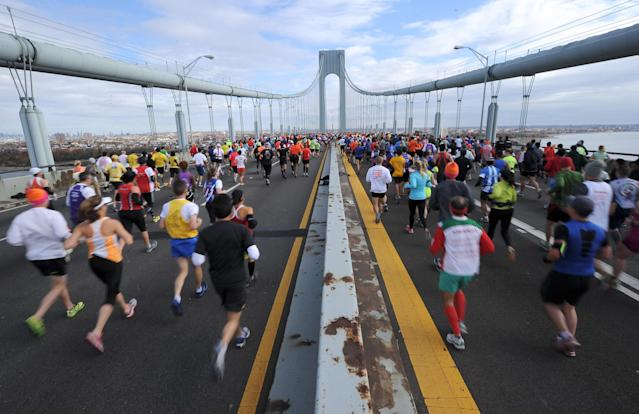 NEW YORK, NY - NOVEMBER 03: Runners cross the Verrazano-Narrows Bridge at the start of the ING New York City Marathon on November 3, 2013 in the Brooklyn borough of New York City. (Photo by Maddie Meyer/Getty Images)