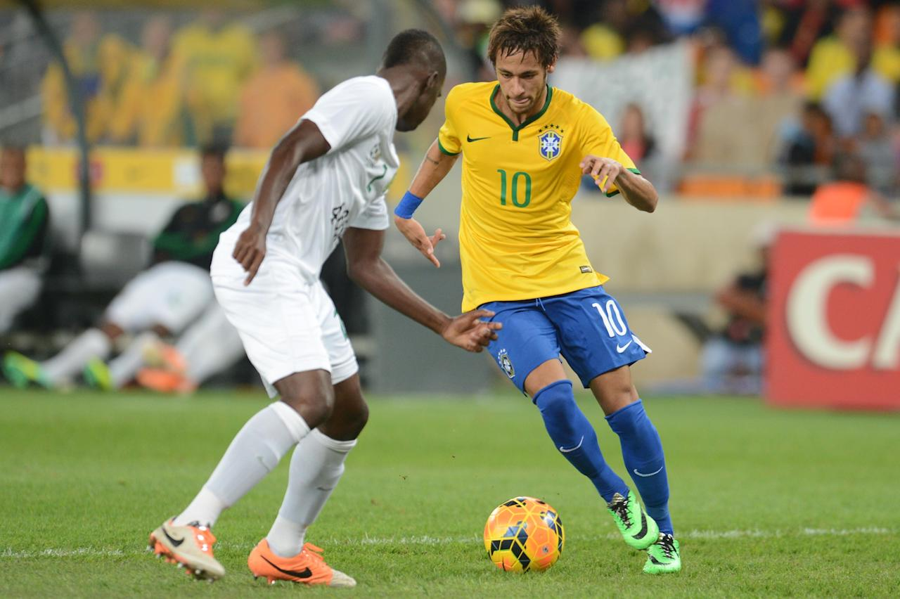JOHANNESBURG, SOUTH AFRICA - MARCH 05: Neymar of Brazil and Anele Ngcongca of Brazil during the International Friendly match between South Africa and Brazil at FNB Stadium on March 05, 2014 in Johannesburg, South Africa. (Photo by Lefty Shivambu/Gallo Images/Getty Images)
